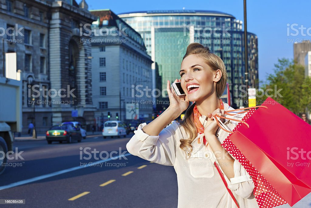 Beautiful commuter with mobile phone royalty-free stock photo