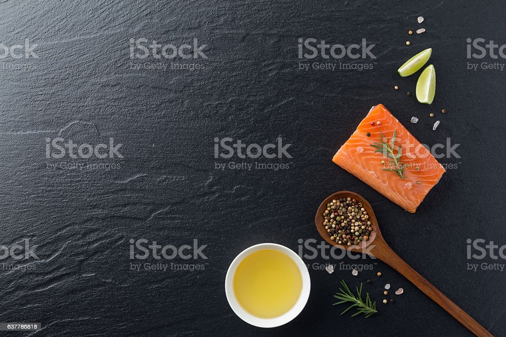 Beautiful composition of fresh salmon fillet with rosemary, salt stock photo