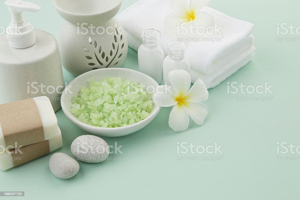 beautiful composition of spa treatment products setting on light stock photo