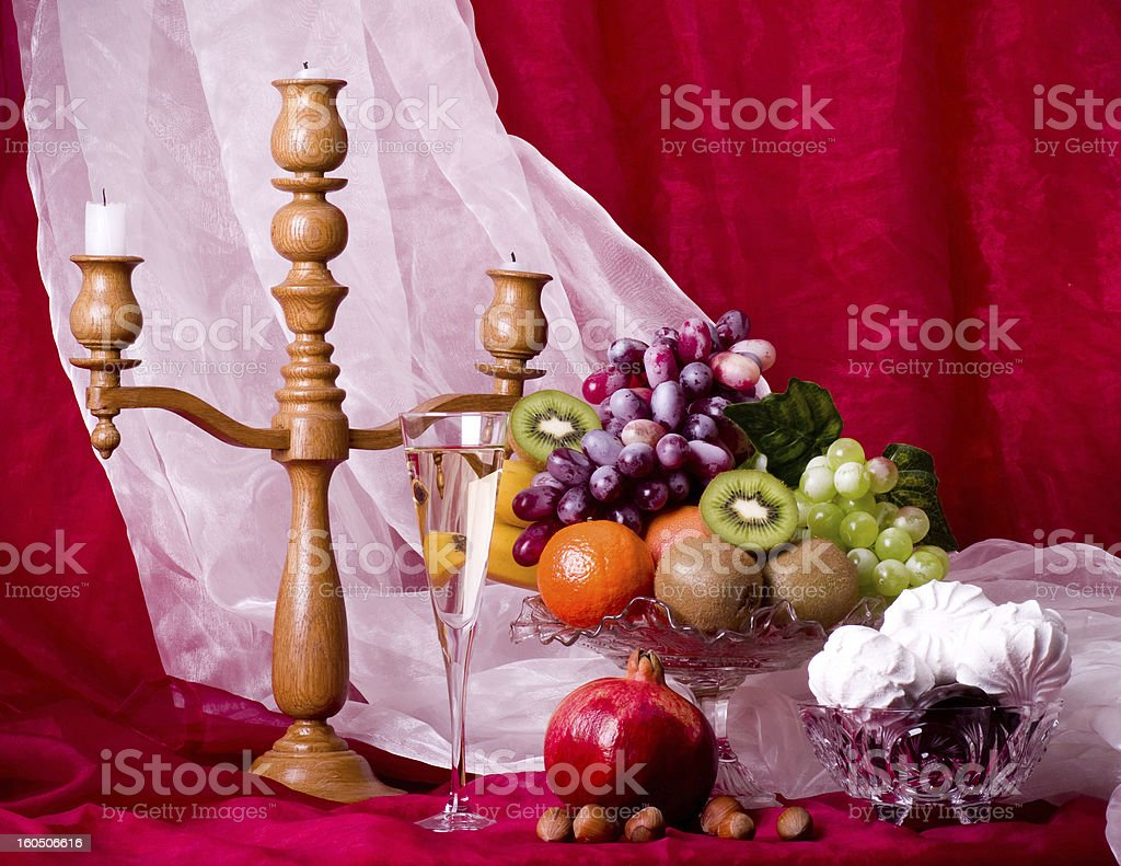 Beautiful composition with fruits, candlestick and wine on vase royalty-free stock photo