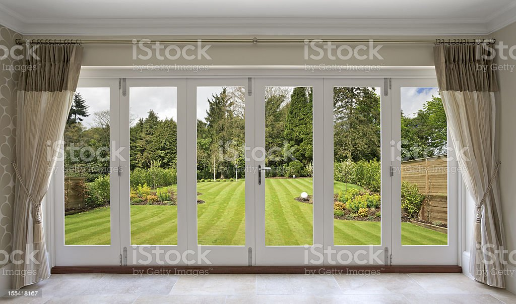 beautiful concertina doors with garden view stock photo