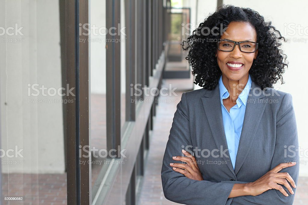 beautiful confident woman wearing a power suit stock photo