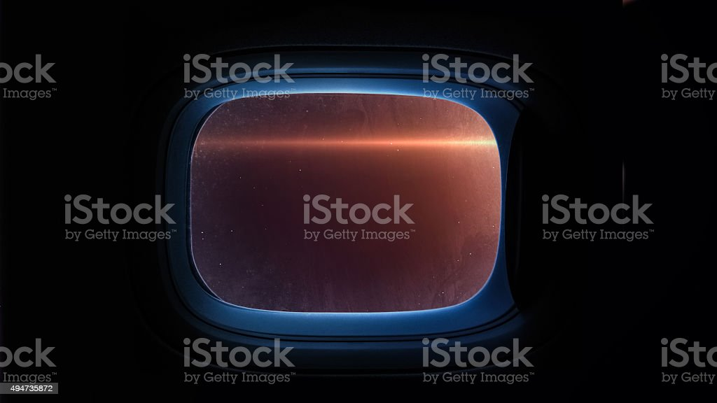 Beautiful cosmos in space ship window porthole. Elements of this stock photo