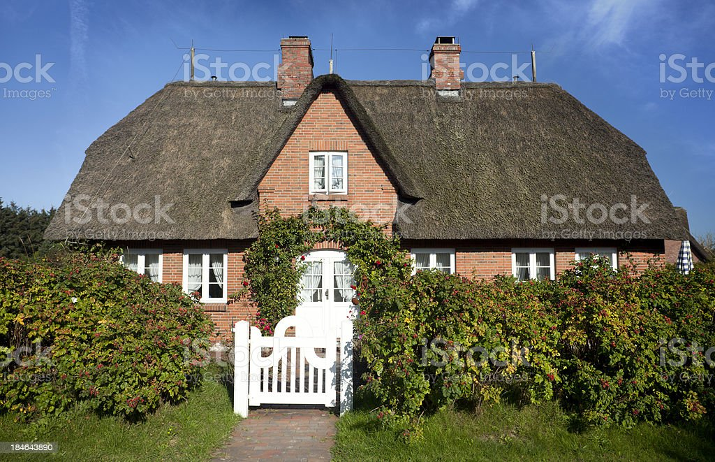 Beautiful Cottage with thatched straw roof stock photo