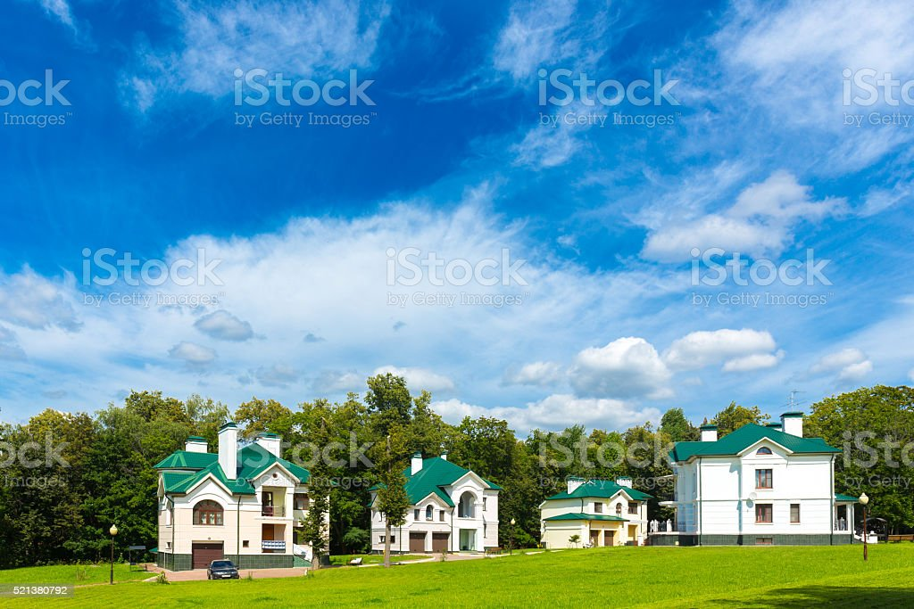 Beautiful cottages under blue sky stock photo