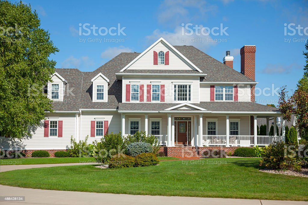 Beautiful country mansion home with circular driveway. stock photo