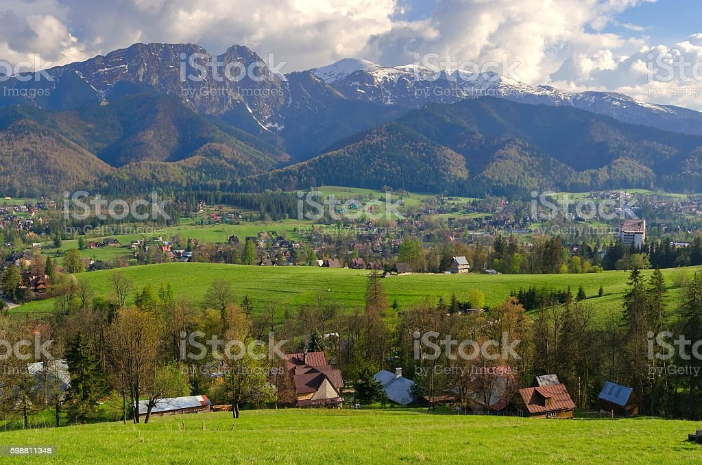 Beautiful country view with mountains in the background. stock photo