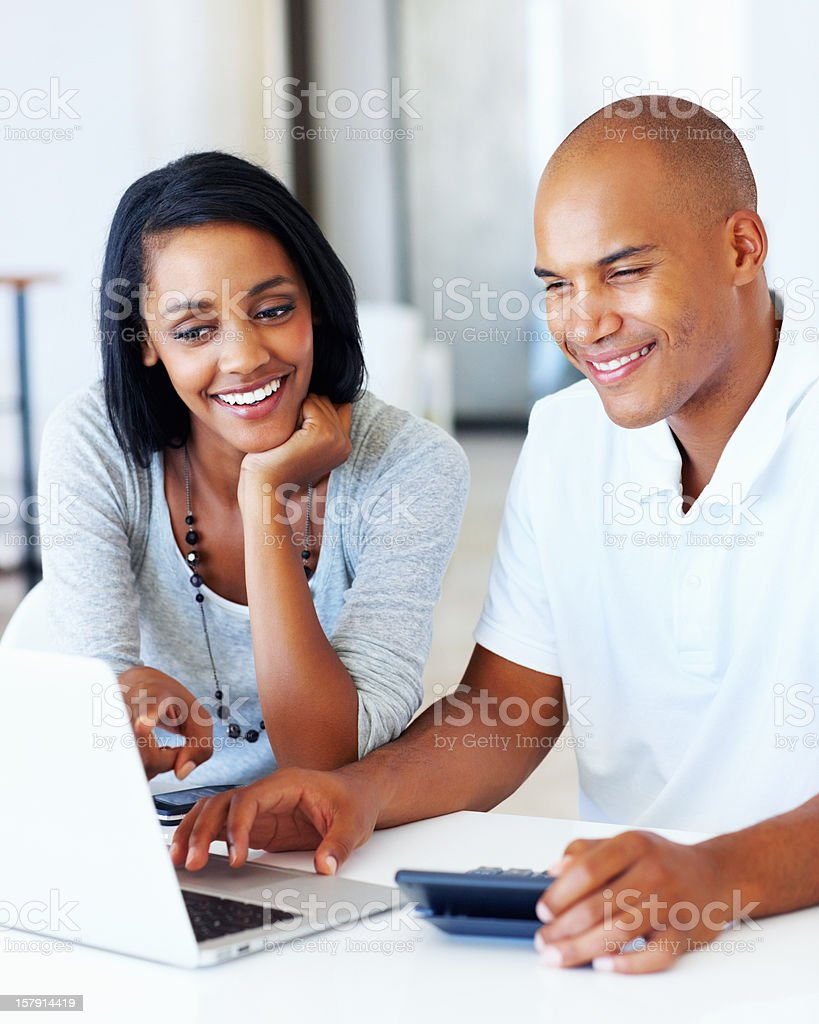 Beautiful couple calculating their expenses royalty-free stock photo