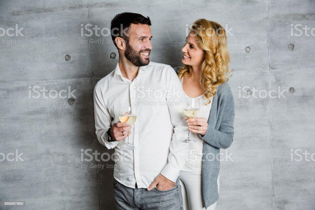 Beautiful couple celebrating stock photo