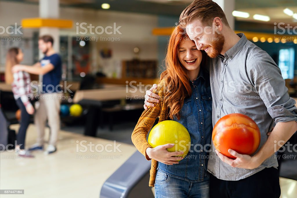Beautiful couple dating and bowling stock photo