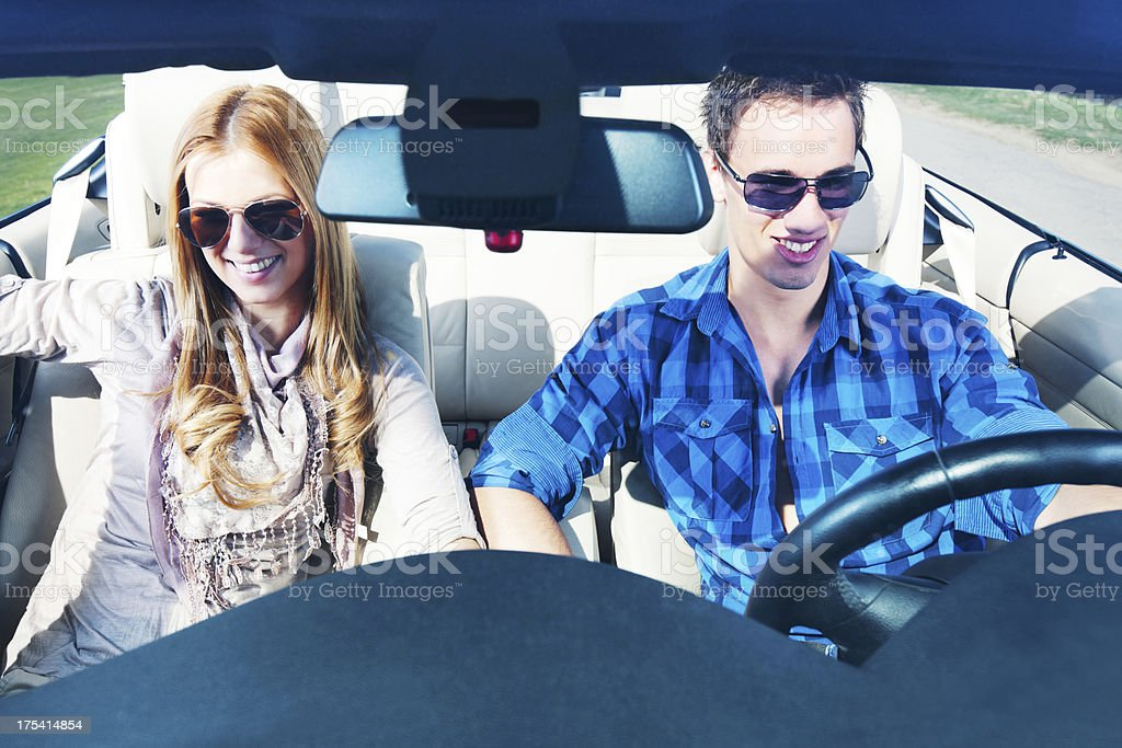 Beautiful couple driving in their Convertible car. royalty-free stock photo