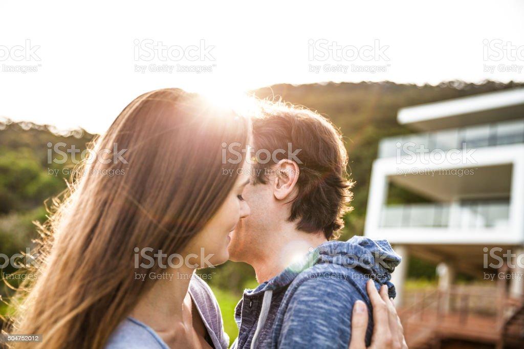 Beautiful couple embracing and enjoying life stock photo