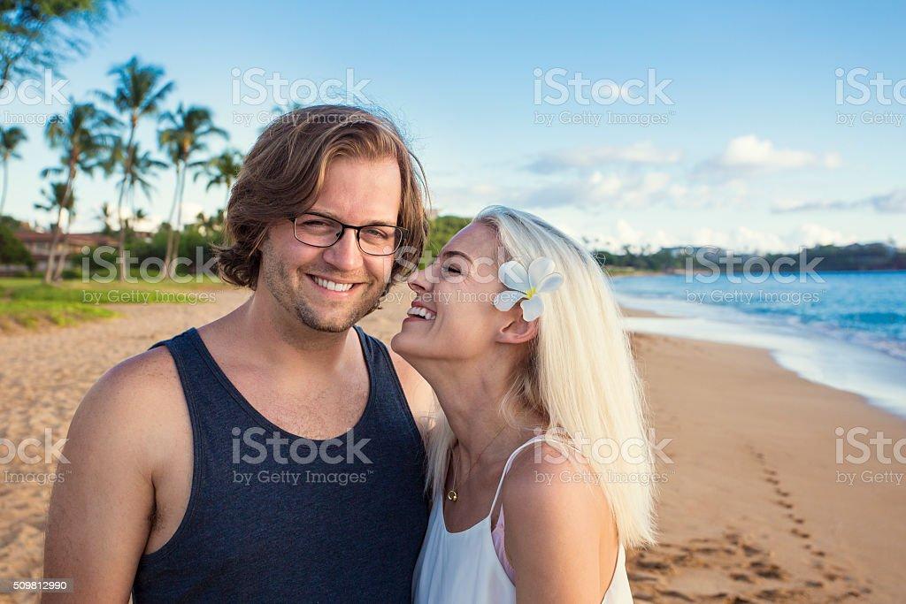 Beautiful couple enjoying an exotic island honeymoon together stock photo