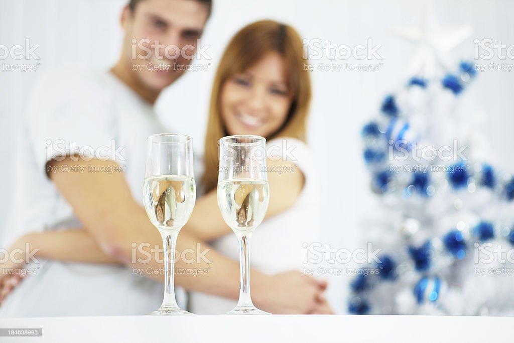 Beautiful couple enjoying at home during Christmas. royalty-free stock photo