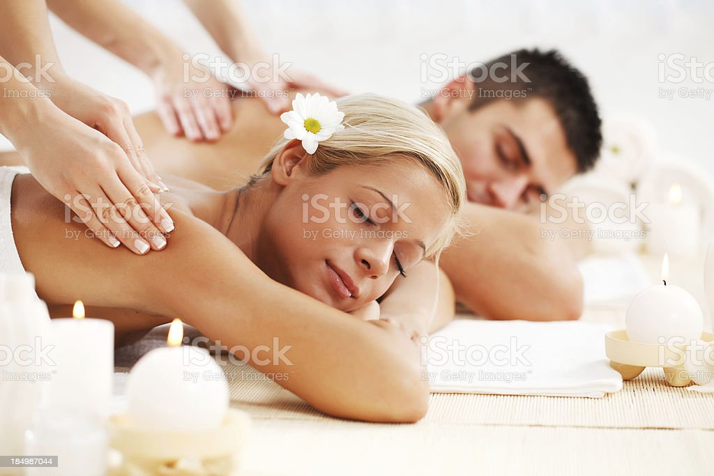 Beautiful couple enjoying in the back massage. royalty-free stock photo