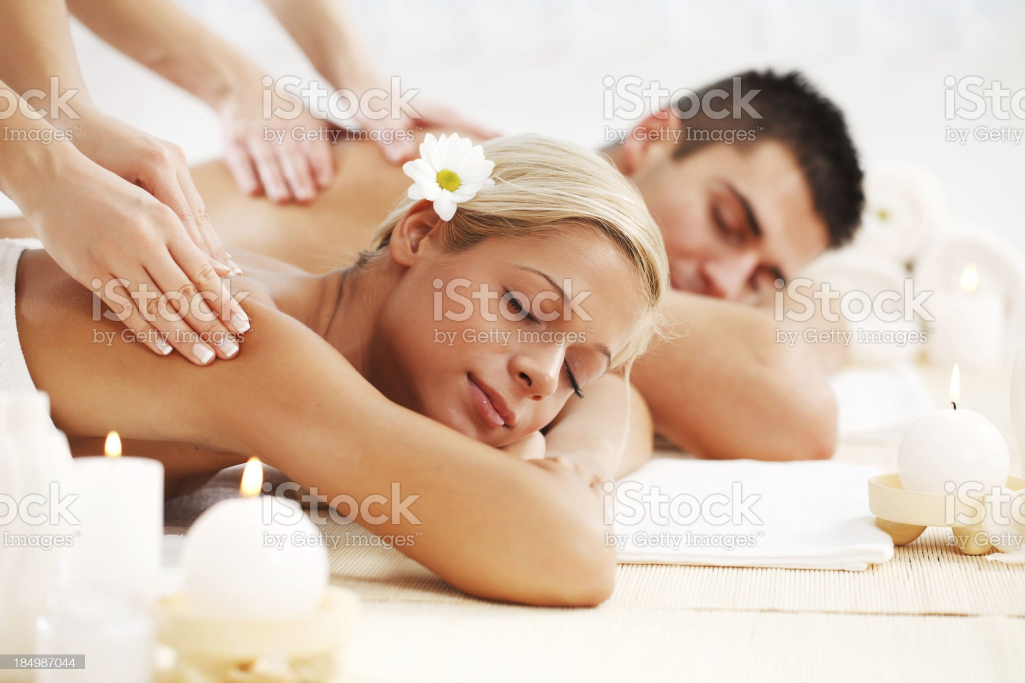 Beautiful couple enjoying in the back massage. royalty-free stock photo