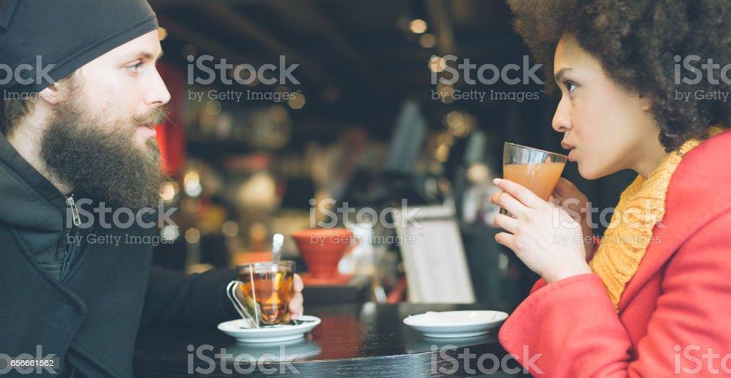 Beautiful couple enjoying tea in a restaurant stock photo