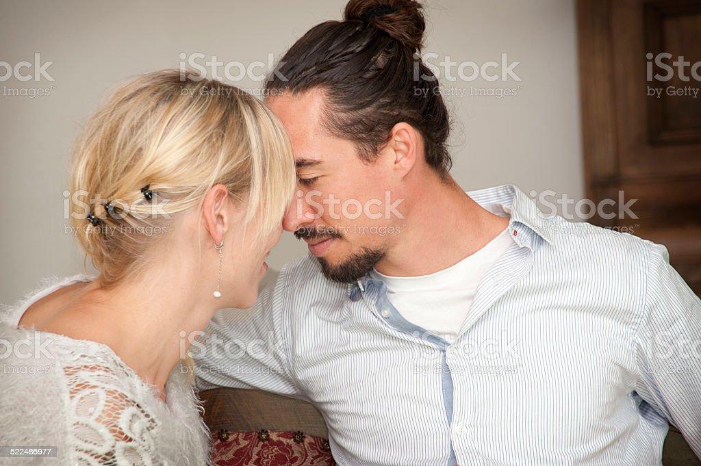 Beautiful couple foreheads touching stock photo
