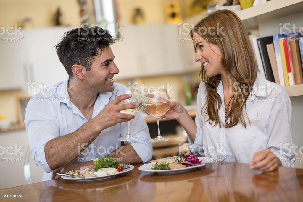 Beautiful couple having dinner stock photo