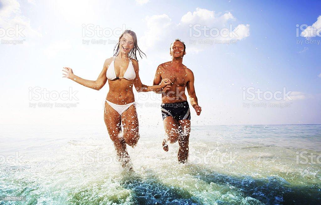 Beautiful couple having fun at the beach. royalty-free stock photo