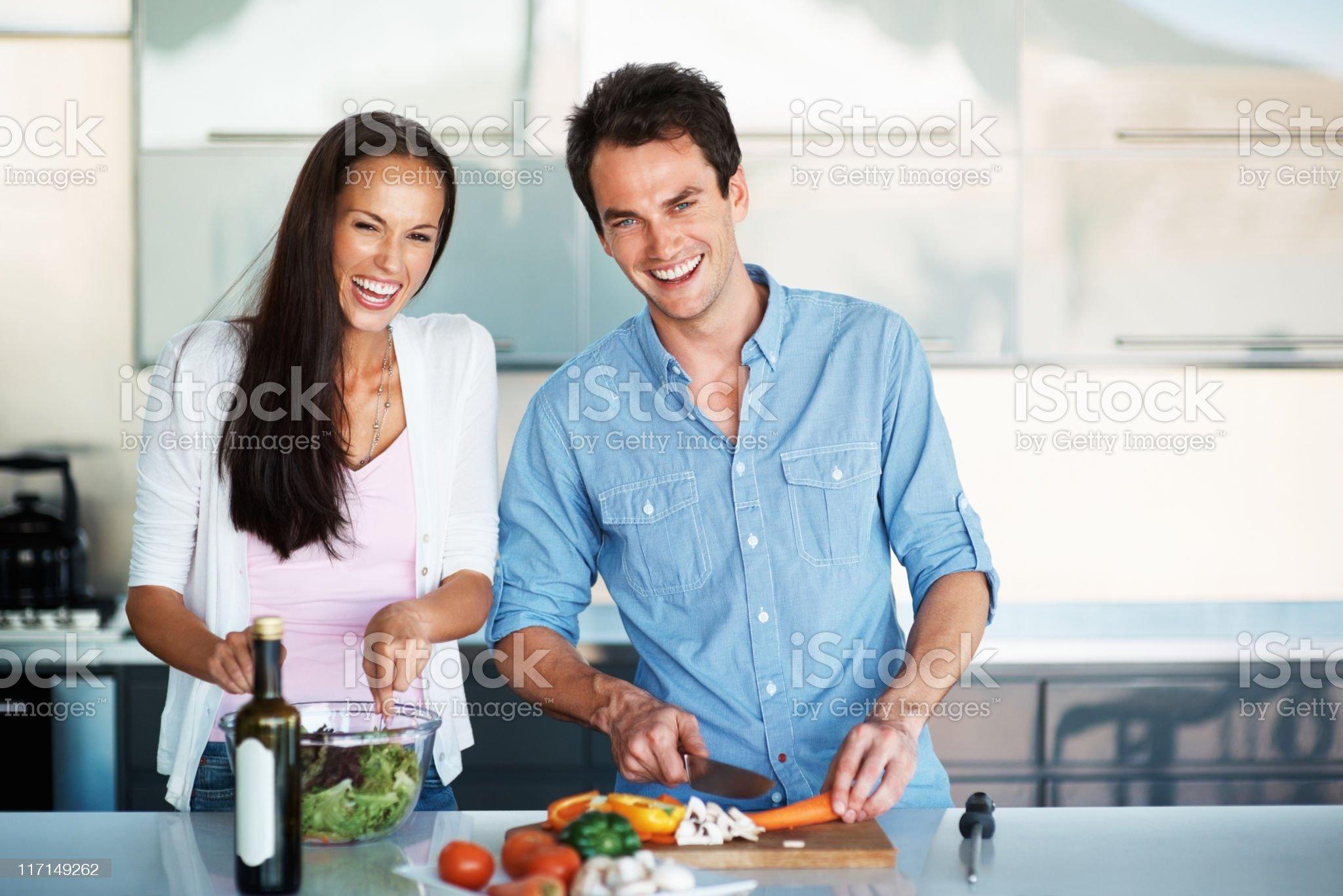 Beautiful couple having fun in the kitchen royalty-free stock photo