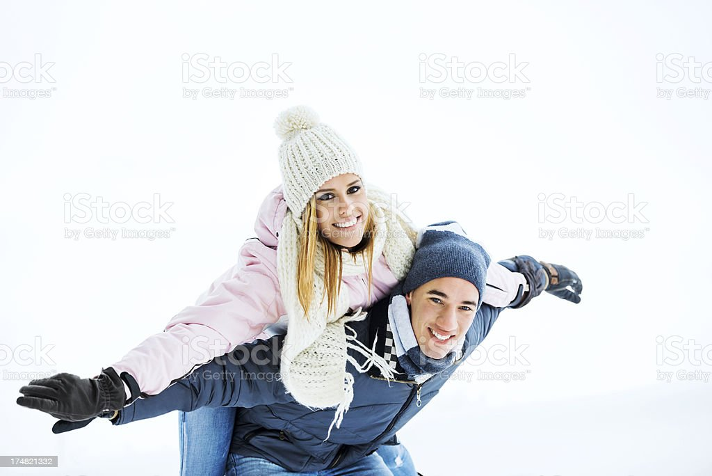 Beautiful couple having fun outdoors during winter season royalty-free stock photo