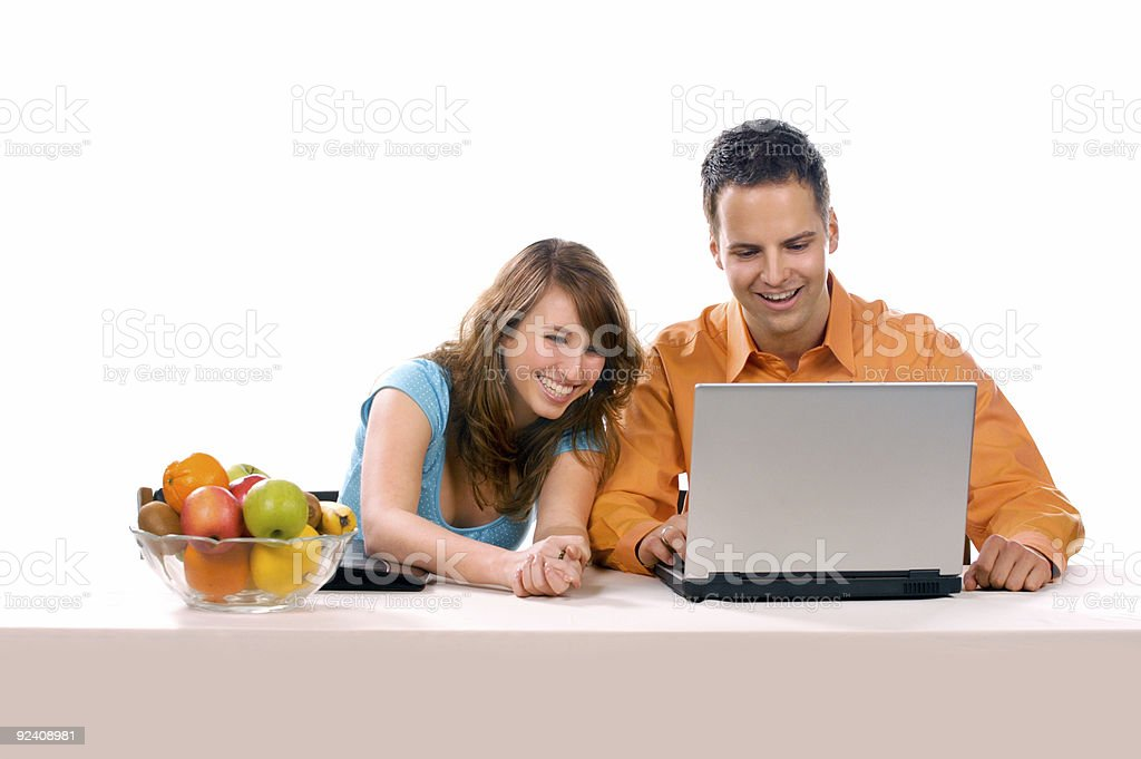 Beautiful Couple Having Fun With The Laptop royalty-free stock photo