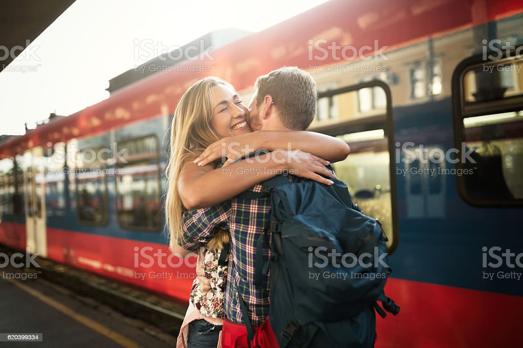 Beautiful couple hugging after long journey stock photo