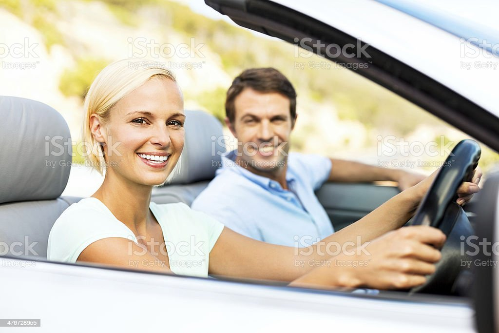 Beautiful Couple In Convertible Car royalty-free stock photo