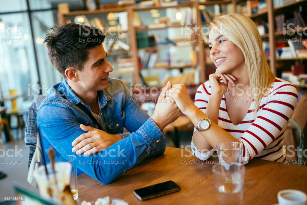Beautiful couple in love flirting in restaurant and bonding stock photo