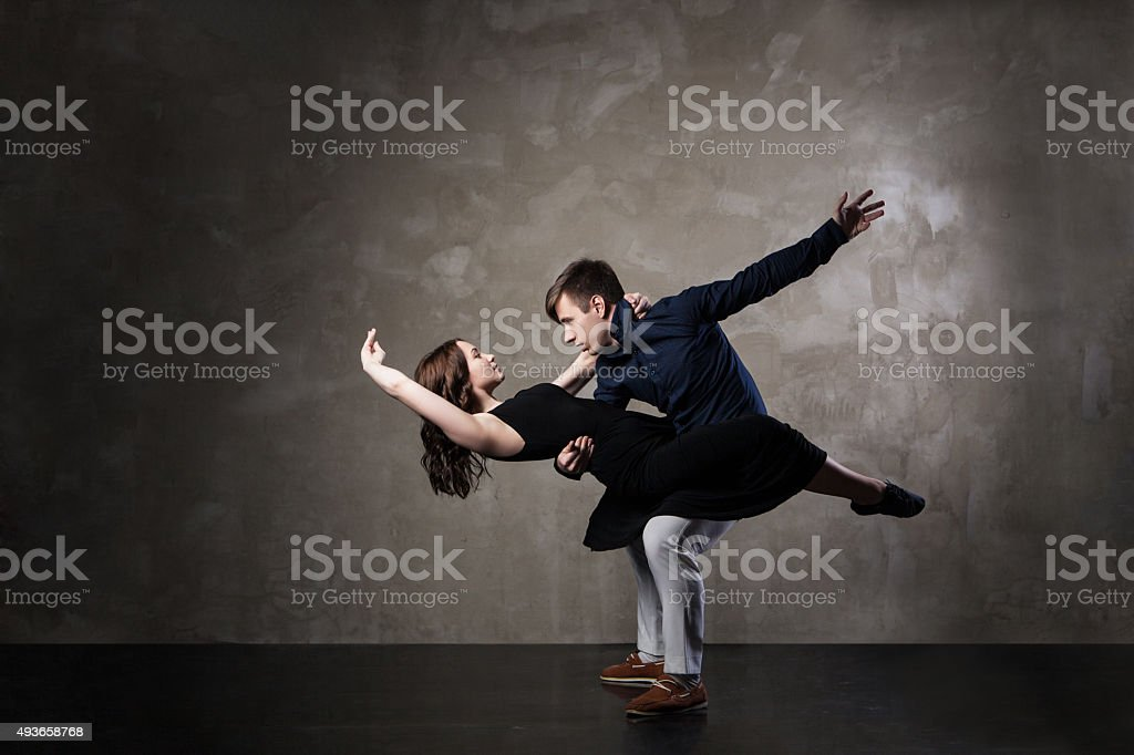 Beautiful couple in the active ballroom dance stock photo