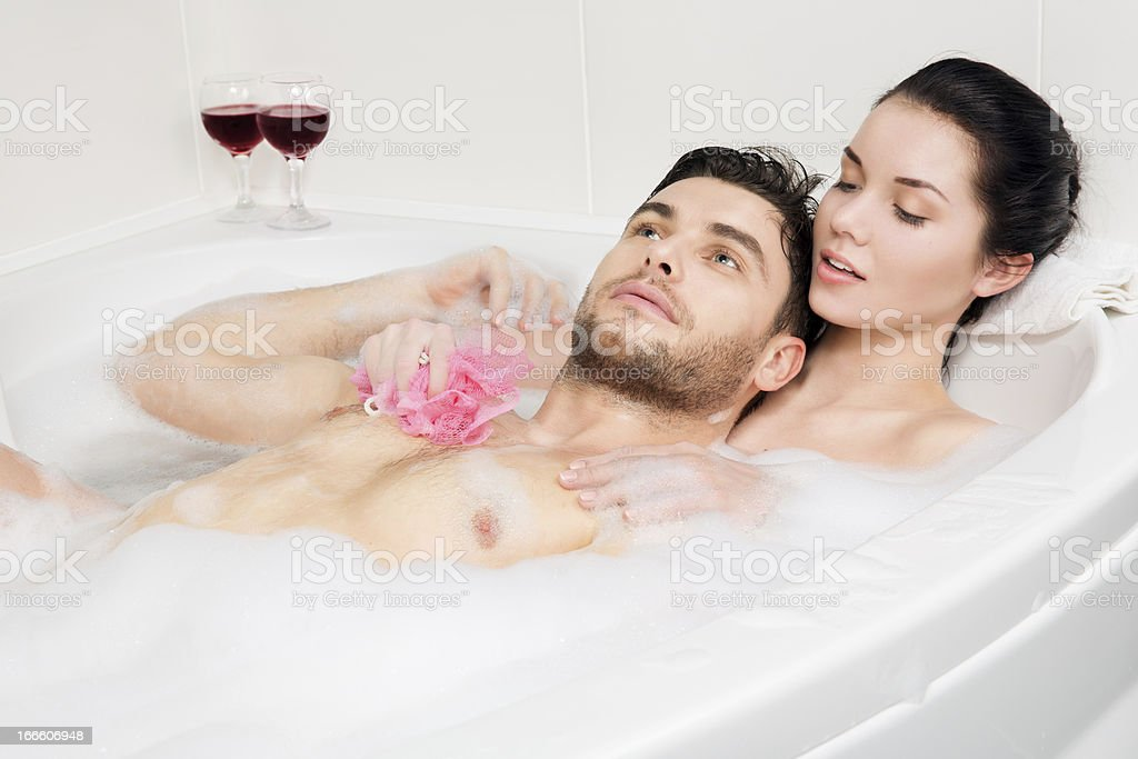 beautiful couple is taking a bath royalty-free stock photo
