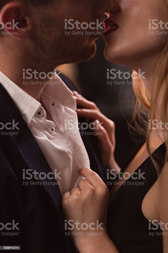 Beautiful couple kissing passionately stock photo