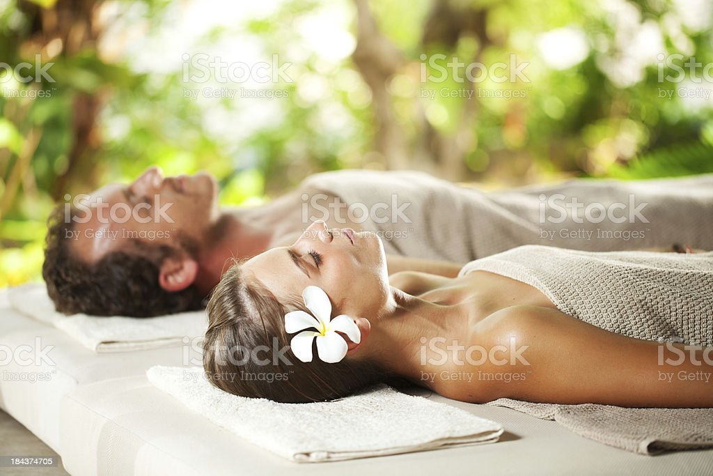 Beautiful couple lying on their backs at a spa. royalty-free stock photo