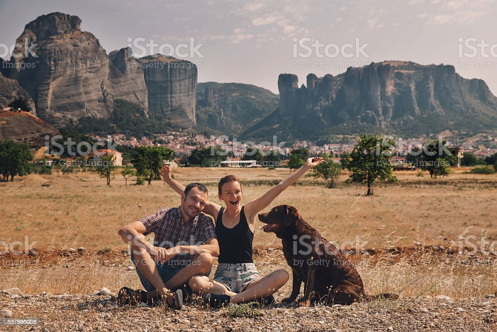 Beautiful couple of tourists in Greece with the Meteora Monaster stock photo