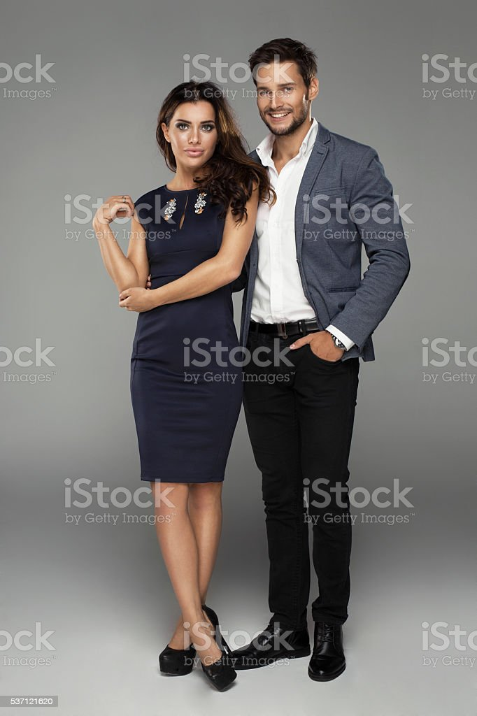 Beautiful couple on grey background stock photo