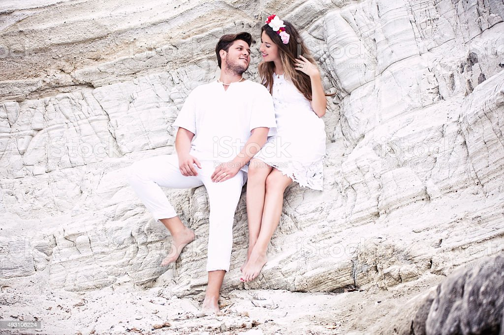 Beautiful Couple On Rocks stock photo