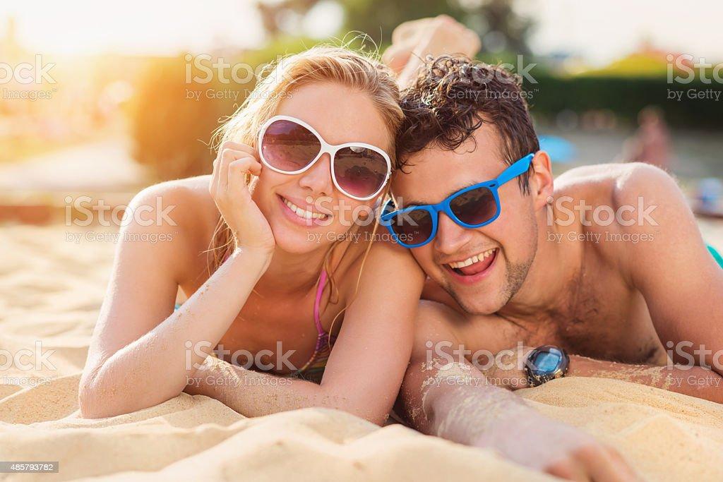 Beautiful couple on the beach stock photo