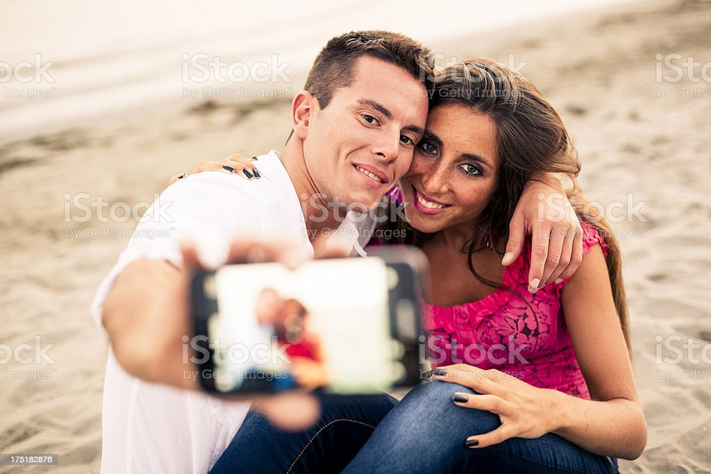 Beautiful Couple photographing themselves royalty-free stock photo