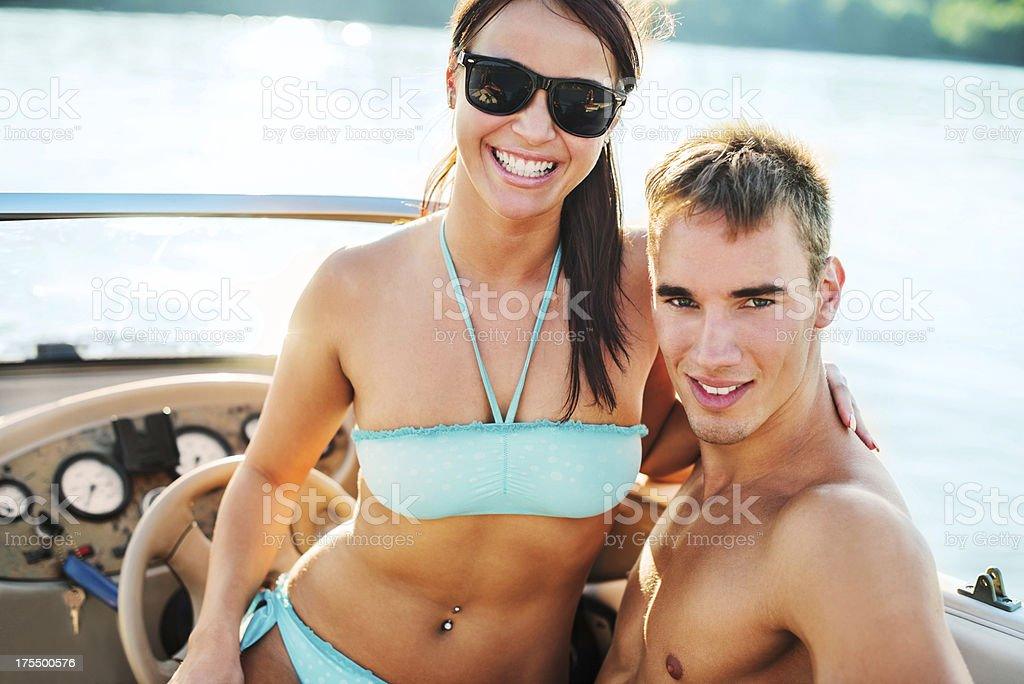 Beautiful couple relaxing in a speedboat. royalty-free stock photo