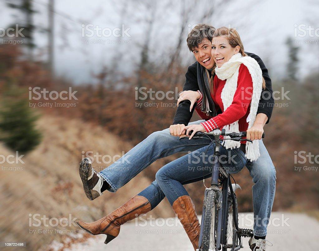 Beautiful Couple riding on a bicycle (XXXL) royalty-free stock photo
