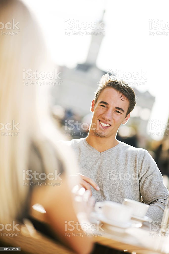 Beautiful couple sitting in a cafe. royalty-free stock photo