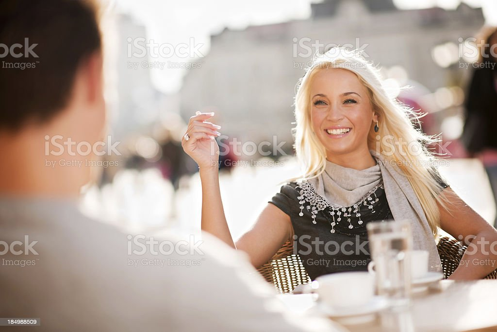 Beautiful couple sitting in a cafe royalty-free stock photo