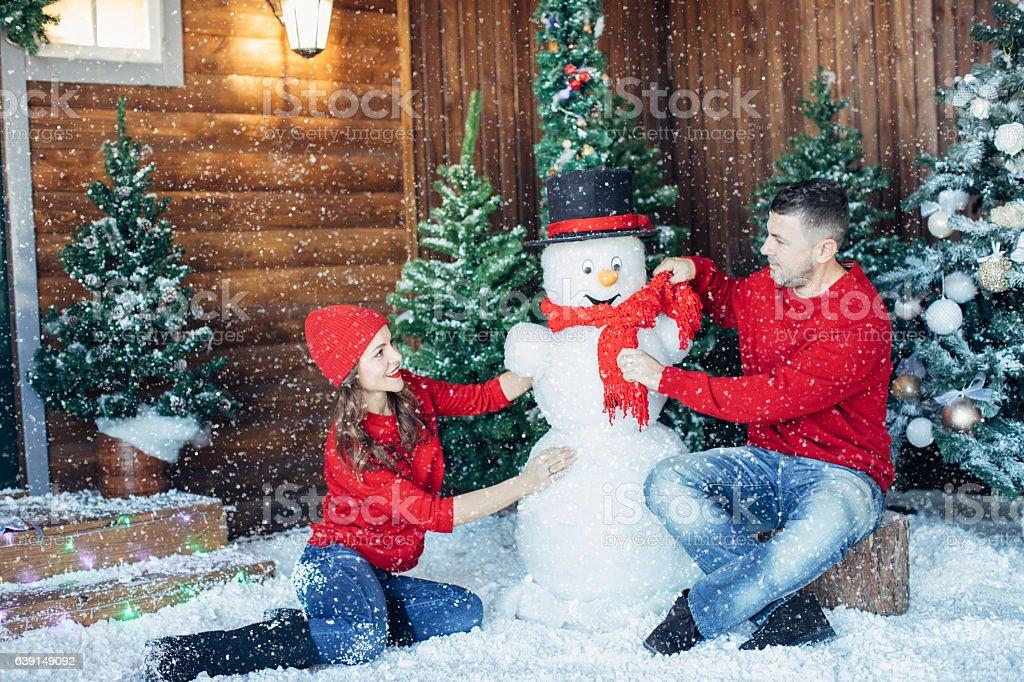 Beautiful couple sitting near their house stock photo