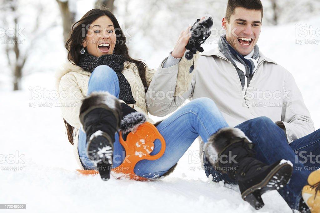 Beautiful couple sledging. royalty-free stock photo