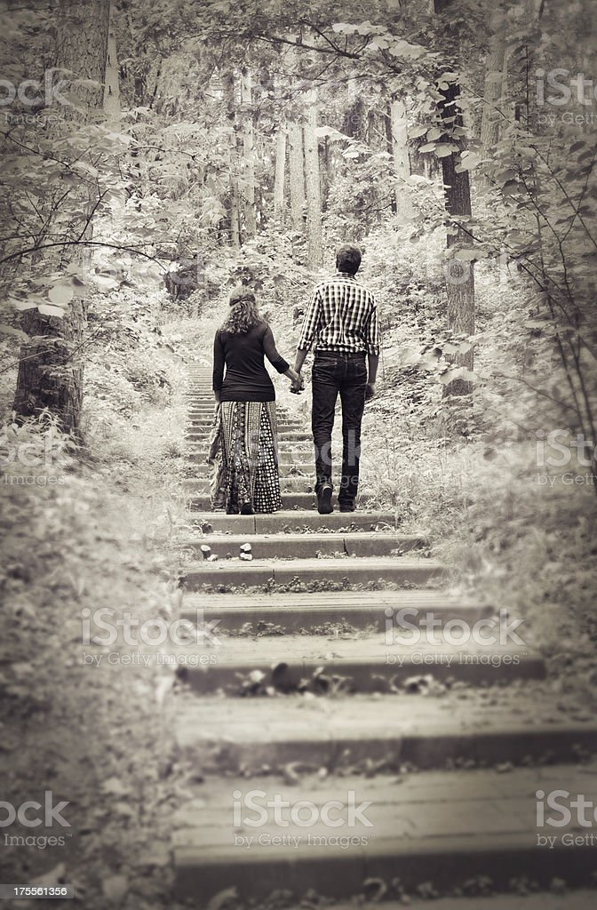 Beautiful couple strolling along the alley royalty-free stock photo
