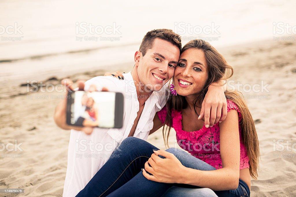 Beautiful Couple taking self portraits royalty-free stock photo