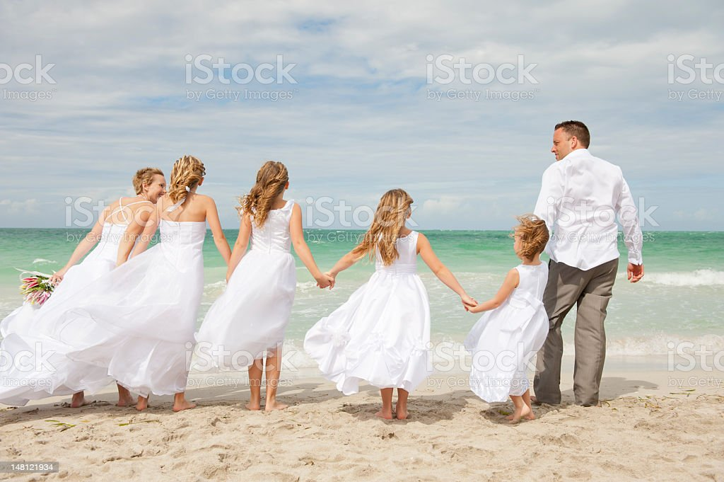 Beautiful couple with family on wedding day stock photo