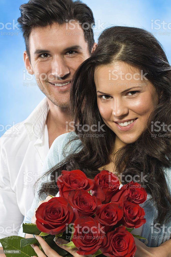 Beautiful couple with flower bouquet royalty-free stock photo