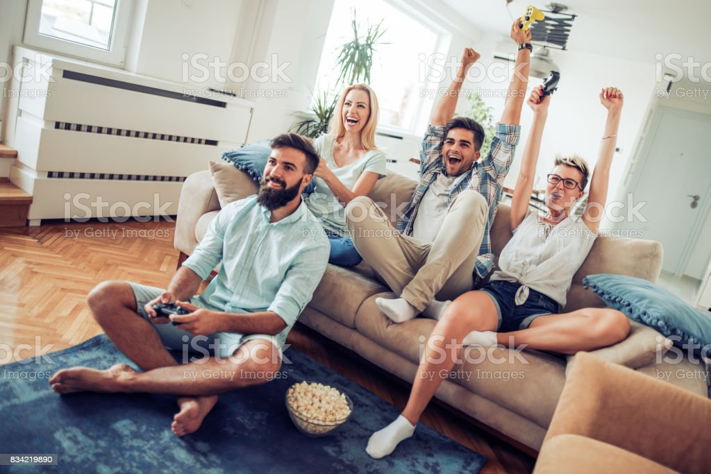 Beautiful couples playing video games on console ,having fun with...
